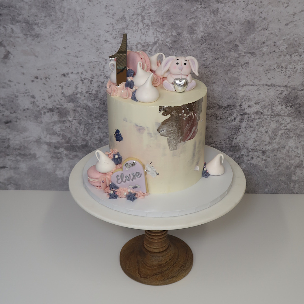 Layer cake with bunny and topper for first birthday