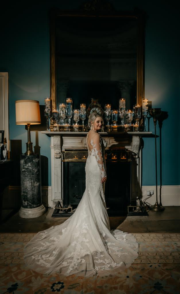 Bride in front of fireplace at Drenagh, Danielle & Gerard, Gemma's Cakes Blog